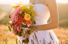 Zinnias + cascading wildflowers are truly divine in this boho bridal bouquet. Don't you think?
