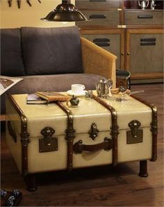 The Ivory Trunk Ottoman holds a  setting for twelve, including champagne flutes and dispensers. It features professional brass hardware, brass locks and keys, steamed cherry wood bent slats, complete with hand turned legs. Honey finished wood inside, Ideal Accent furniture for the Bar and Home. $569.99 plus additional savings now!