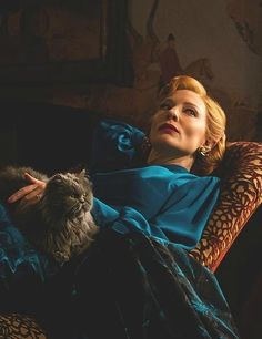 blue blouse with gold pendant accent . cinderella 2015 // cate blanchett as lady tremaine