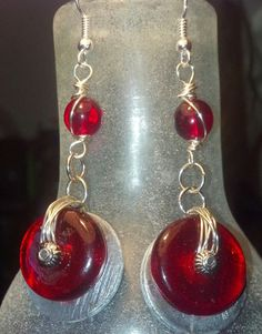 Aluminum wire wrapped 3/4' #washers with 1/2' circular #crimson #red glass beads, 4mm round red beads #silver tone on french hook wire earrings. These #earrings will set off any... #trending #handmade #antique #beach #jewelry #beaded #metal #rustic #dangle #different