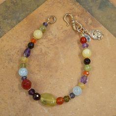 Mixed gemstone chakra bracelet with beautifully detailed bronze Buddha