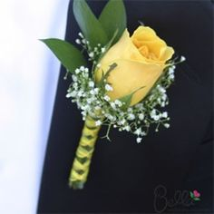 Groomsmen boutonniere but with a pink rose and green ribbon