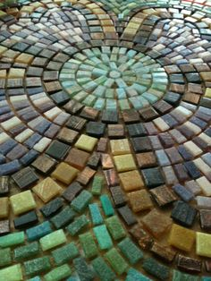 Mosaic table top... great job with the color layout.