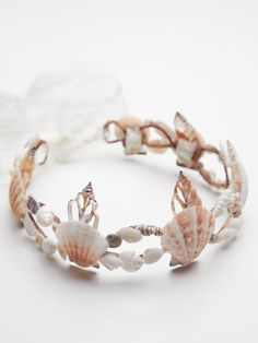 Calypso Mermaid Crown | Be the mermaid princess of your dreams in this delicate crown made from real seashells that was handmade in Santa Barbara, California. * Adjustable lace tie closure * Each design is one-of-a-kind due to the natural variations in seashell color, shape, and size.
