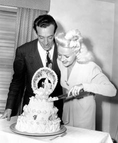 Betty Grable and band leader Harry James wedding in 1943. They remained married until 1965, tho it was stormy due to (everyone said) Harry's notorious drinking and womanizing. I remember leaving work to go with my mom to her funeral in '73 - mom didn't want to go alone and dad was out of the country. Wow! Was that an 'old Hollywood' paradise of faces who showed up at that one. I wanted to have my camera there only you don't do that at a funeral!