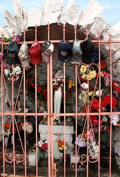 Roadside shrine, baseball caps