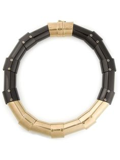 Black and gold brass articulated necklace from Lanvin featuring gold-tone hardware and a top clasp fastening.
