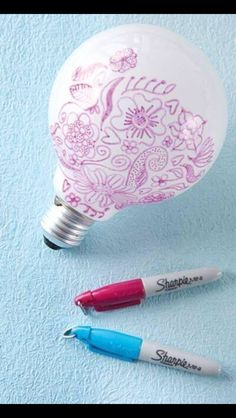Cool! Draw on a light bulb to make designs on the walls