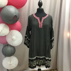 This is GoRgEoUs!! The sleeves on this dress are pintucked and certainly sets this dress apart from any others. Beautiful pink neckline and dainty pink print. Flower are HUGE right now. 65% cotton 35%