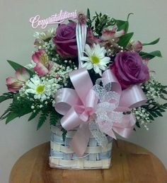 Welcome Home Baby Girl Arrangement. Lavender Roses, Babys Breath, Daisies and Alstromeria.