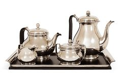 Danish Mid-Century Modern stainless steel/silverplate coffee and tea set with tray, coffee pot, teapot, creamer, sugar, with ebonized rosewood handles and tray surface, circa 1960. Stamped ALP Denmark on bottom of each piece.