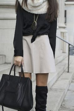 Bulky sweater over a skirt, and over-the-knee boots and a big scarf. Such a cute look!