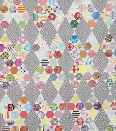 A hexagon and a kiss all in one quilt. What more could you need? The finished quilt measures 66 inches by 85 inches.