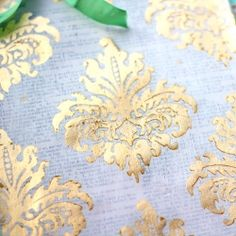 Here's an easy to follow tutorial with step by step video, showing how to make your own vintage wallpaper-inspired gold leaf paper.