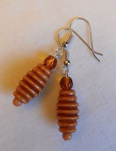 Handmade Earrings Spiral Wood Wooden Beads with Amber Bead Accent. by Ivybeehive. Wooden Earrings, Wooden Jewelry, Wooden Beads, Beaded Earrings, Earrings Handmade, Drop Earrings, Wood Burning Patterns, Amber Beads, Wooden Art
