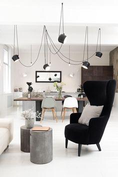 loooox concrete column side tables and black moooi armchair