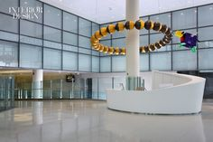 The Art of Healing: Johns Hopkins Hospital by Perkins + Will | The reception desk in the children's lobby is surveyed by Israel's Cow Jumping Over the 28 Phases of the Moon in painted fiberglass and steel. #interiors #interiordesign #interiordesignmagazine #projects #health #wellness