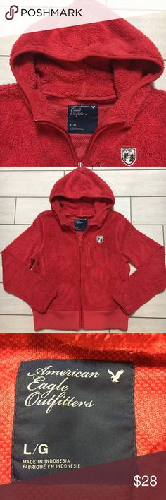 """American Eagle Plush Hooded Jacket Size Large. Sits at the waist almost like a crop jacket. Very soft and warm. 100% Polyester. Measures 24"""" from top of shoulder to waist. Color is like a burnt orange red or a pale red. American Eagle Outfitters Jackets & Coats"""