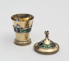 The Mérode Cup  Object: Cup and cover  Place of origin: France (probable, made)  Date: ca. 1400 (made)  Artist/Maker: Unknown (production)  Materials and Techniques: Silver, silver gilt, gold; plique-à-jour enamel plaques