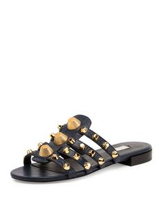 "Balenciaga lambskin sandal with ""Giant 12"" golden studs. 0.5"" flat stacked heel. Open toe. Caged vamp. Slide-on style. Smooth outsole. Made in Italy."