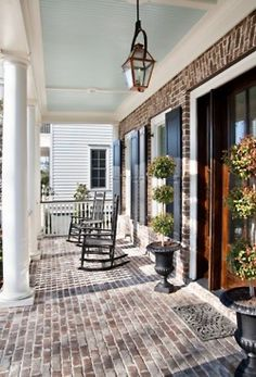 Don't forget to stage the outside as well!    Brick front porch & blue bead board ceiling