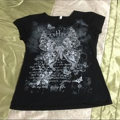 Glittery Butterfly Top Glittery butterfly top. Very cute. Says Large but sized small. Reserved Tops Tees - Short Sleeve