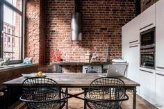 kitchen / loft with brick walls and wood