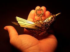 Clockwork Canary ... complete with brass clockworks, gears and turn key.