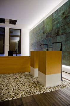 Island Stone - loose pebble floor. They have incredible selection of stone, pebble and claddings....