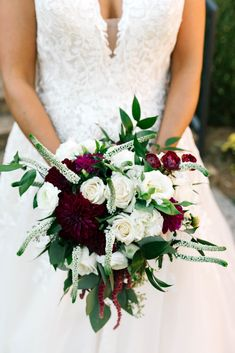 These deep Burgundy dahlias added so much depth to this stunning bridal bouquet! Photo credit: Smash Studios Photography.