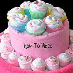 Washcloth cupcakes    https://www.youcanmakethis.com/products/baby/washclothcupcakesminiandfullsizeinstructionalvideo.htm