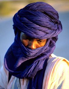 The Tagelmust is a 16.5 foot long veil wrapped into a turban that is dyed with indigo.