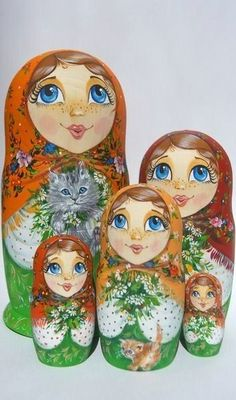 A set of five matryoskas (Russian nesting dolls) with big blue eyes. Bouquets of field flowers and two kittens make these matryoshkas more attractive. #Russian #folk #art #matryoshka