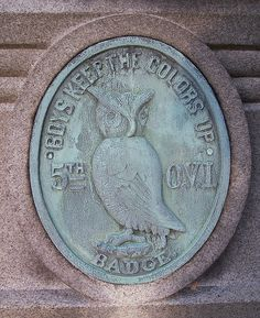 """""""Boys Keep the Colors Up"""" was the motto for the 5th Ohio Volunteer Infantry Regiment, a unit designated for service to the Union Army during the Civil War. It is carved in bas relief on bronze complete with an owl and the name of the regiment and is located on the facing of a monument erected in 1895 by the surviving members of the regiment at Spring Grove Cemetery in Cincinnati, Ohio. Several hundred of the regiment's veterans are buried at the cemetery. Photo by Rufus Kevin Guy, Cincinnati, OH"""