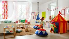 cheerful playroom.  Love the sectional and the tent