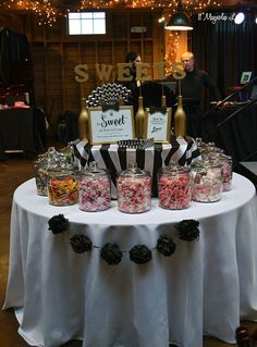 Simple Candy bar; Formal event decor: black and white stripes with gold