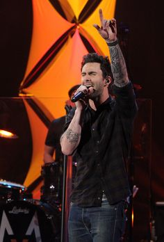 Adam Levine rockin out with Maroon 5