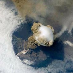An erupting volcano seen from International Space Station.