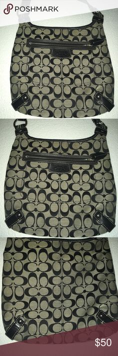 Black and gray Coach crossbody Black and gray Coach crossbody that is super convenient for being on-the-go. Fits everything you need. Great size. Has nifty pockets. L: 11 1/2 in, H: 10 1/2 in, W: 1 in. Coach Bags Crossbody Bags
