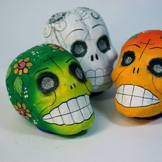 Can skulls be charming? These three amigos were handmade in Jalisco and come in three choices of color. One of each available. The big smiling, toothy grins remind us how happy they are to come back to visit their friends and relatives during the Days of the Dead on November
