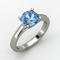 Classic with a modern twist and a cool blue stone. So hard to choose!!