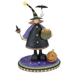 Girl Witch Holding Candy Corn Halloween Figurine