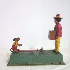 Rare Vintage Cast Iron Hubley Toy Organ Grinder  Bank ( Monkey Bank) comes from the Ruby Lane Shop of Something Wonderful.