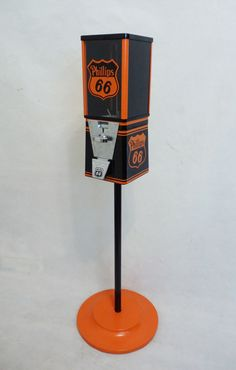 vintage Oak gumball machine themed PHILLIPS 66+ stand