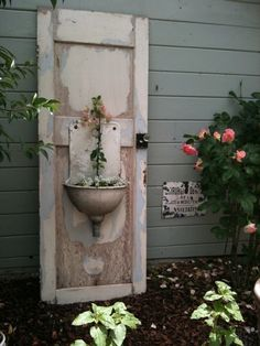 Salvage sink and door garden fountain decor.