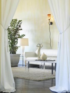 Modern white living room from Ron Nowfel