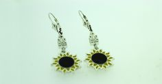 Handcrafted .925 sterling silver or 14kt gold plated .925 sterling silver sunflower earrings with tryzub.