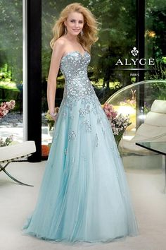A tulle and sequined lace gown with sweetheart neckline by Alyce Designs