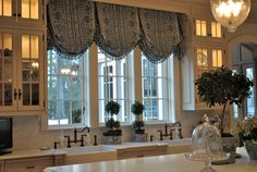Luv the lights in the cabinets and the Topiaries on the sink