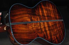 Incredibly rare figured Indian Rosewood on the back of a Taylor BTO 12-fret guitar.